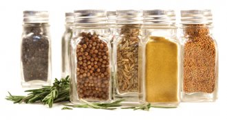 Spice jars with various herbs
